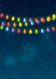 Christmas lights. On night sky background Royalty Free Stock Image