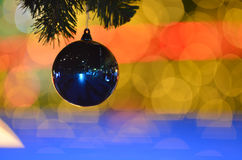 Christmas lights. Christmas Ornament with Lighted Tree in Background Royalty Free Stock Images