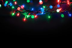 Christmas lights over black background royalty free stock images