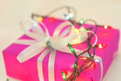 Christmas lights and packaged gift Stock Photography
