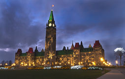 Christmas Lights on Parliament in Ottawa. Christmas lights on the Center Block with clock spire located at Parliament Hill, Ottawa, Ontario, Canada 2011 royalty free stock photo