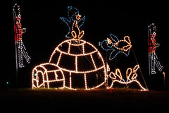 Christmas Lights - Penguins and Igloo. A colorful christmas holiday light display of penguins playing on an igloo and other winter fun in lights Royalty Free Stock Images