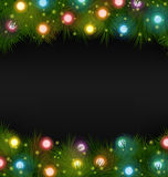 Christmas lights on pine on black Royalty Free Stock Photography