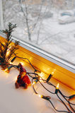 Christmas lights, pine branch and cute elf. Window with Christmas lights, pine branch and cute elf stock images