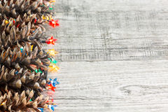 Christmas lights and pine cones Stock Image