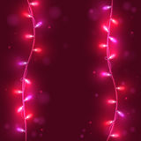 Christmas lights on pink background, bright lights, stock images