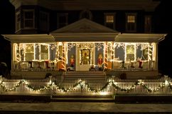 Christmas Lights on the Porch. A brightly lit and decorated porch on an old Victorian-Era home at Christmas in Cape May, New Jersey Stock Photography