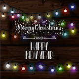 Christmas lights poster. With shining and glowing garlands on wooden background Lettering Merry Christmas and a Happy New Year. Web banner vector illustration Stock Photo