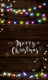 Christmas lights poster with shining and glowing garlands. On wooden background Lettering Merry Christmas. Web banner vector illustration Stock Photo