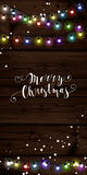 Christmas lights poster with shining and glowing garlands. On wooden background Lettering Merry Christmas. Web banner vector illustration Royalty Free Stock Photos