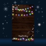 Christmas lights poster with shining and glowing garlands. On wooden background Lettering Merry Christmas. Web banner vector illustration Royalty Free Stock Images