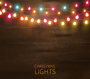 Christmas Lights Poster. With shining and glowing garlands on wooden background vector illustration Royalty Free Stock Image
