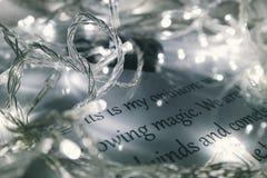 Christmas lights on printed page