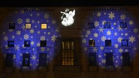 Christmas lights projected on the facade of a building, Varese stock video