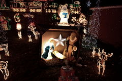 Christmas lights. Public holidays home lighting, crib, colored lights, Santa Claus, reindeer, snowman, little Jesus, the saints, the star of Bethlehem, a Royalty Free Stock Photography