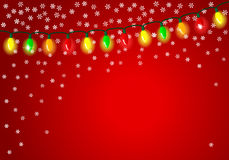 Christmas lights on red background with space for text Royalty Free Stock Photo