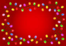 Christmas lights on red background with space for text Stock Image