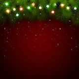 Christmas lights on red background Royalty Free Stock Images