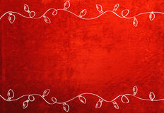 Christmas Lights. A red velvety background is framed by two drawn strands of Christmas lights Stock Photos