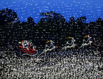 Christmas lights Santas sleigh and reindeers Royalty Free Stock Image