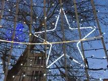 Christmas lights and shining star.  stock photography