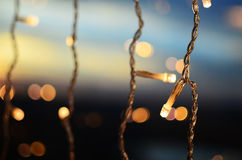 Christmas lights on sky background Stock Image
