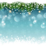 Christmas lights and snow. On a bokeh lights background Royalty Free Stock Image