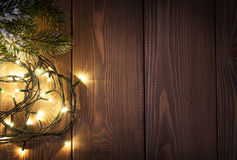 Christmas lights and snow fir tree Stock Photos