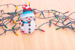Christmas lights and snowman Royalty Free Stock Photography