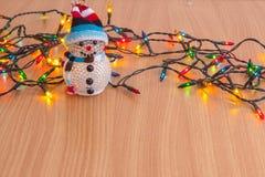Christmas lights and snowman Stock Photography