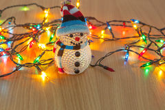 Christmas lights and snowman Stock Images