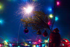 Christmas lights and sparkler. Blue is dominant Royalty Free Stock Images