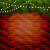 Christmas lights with spruce branches on a brick wall. Christmas background with fir tree branches and light bulbs on a brick wall, illustration Royalty Free Stock Image