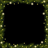 Christmas lights on spruce (fir) branches on black background. Border Royalty Free Stock Photography