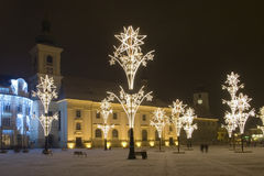 Christmas lights square of sibiu transylvania. Christmas lights in main square of sibiu transylvania with illuminated church and snow Royalty Free Stock Image