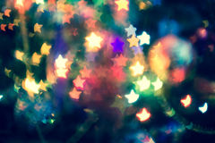 Christmas Lights Star Bokeh. Festive background with star shaped bokeh from Christmas tree lights glowing Stock Images