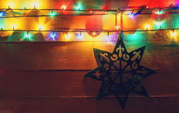 Christmas lights and star on wood Royalty Free Stock Images