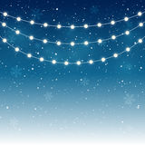 Christmas lights. On starry background Royalty Free Stock Photography