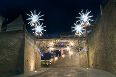 Christmas lights on street and bridge in Sibiu. Christmas and new year lights decorated architecture bridge with brick walls town entrance in Sibiu Transylvania Royalty Free Stock Photos