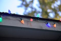 Colorful lights for christmas along a roof