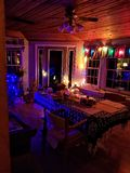Sunroom lights at night. Christmas lights in sunroom at night stock photo