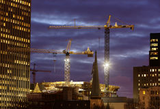 Christmas lights on tower cranes Stock Images