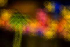 Merry Christmas with lights and toys. Christmas lights and toys and tree seen through frosted glass. Concept of festivals Royalty Free Stock Images