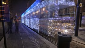 Christmas lights tram leaving royalty free stock image