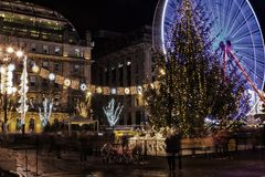 Christmas lights, Christmas tree and Christmas market in George. Christmas lights, Christmas tree and fairground attractions in George Square, Glasgow, UK royalty free stock photos