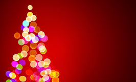 Christmas lights on tree, out of focus Royalty Free Stock Images