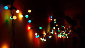 Christmas lights. On the wall royalty free stock photos
