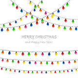 Christmas lights on white background Stock Images
