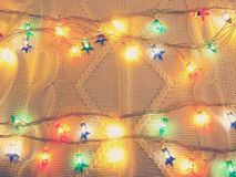 Christmas lights on white knitted sweater Royalty Free Stock Photo