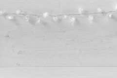 Christmas lights on a white wooden background. Xmas background royalty free stock photo